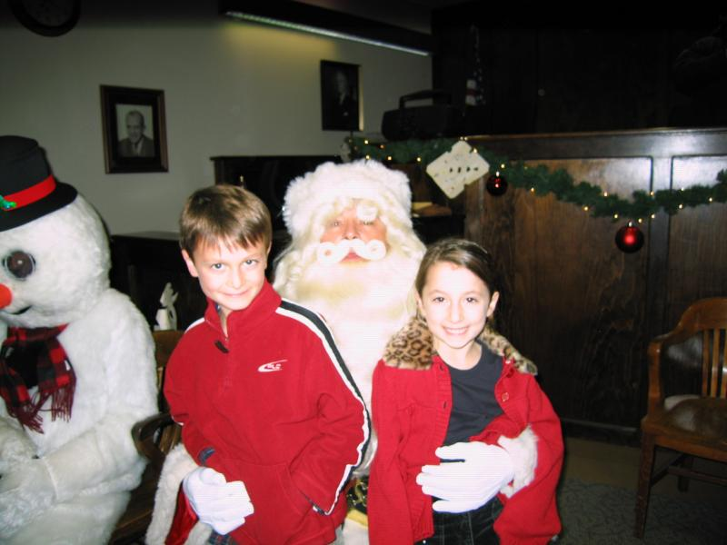 2 kids on Santa's lap