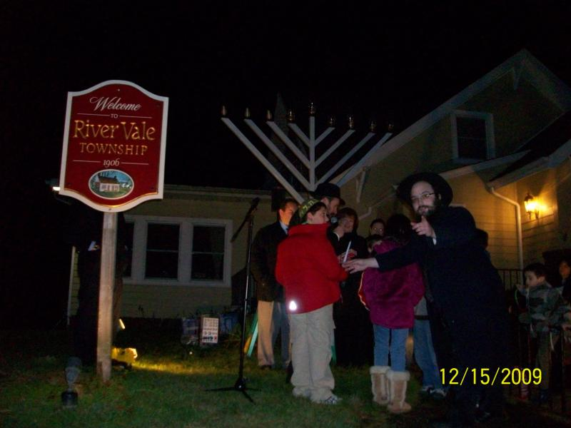 A large menorah in front of a house
