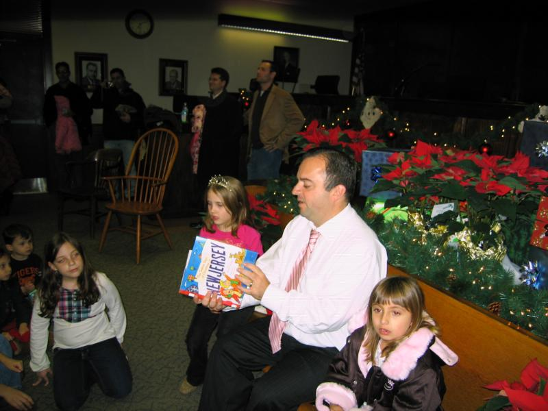 A man reading to children