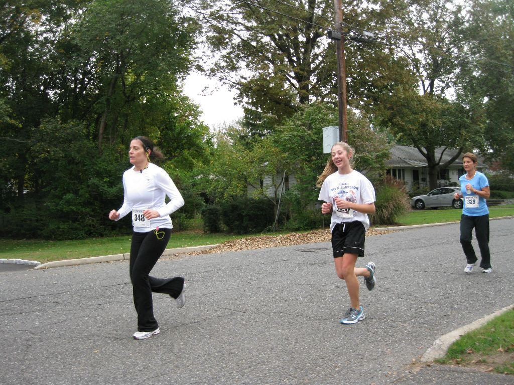 3 ladies running outside