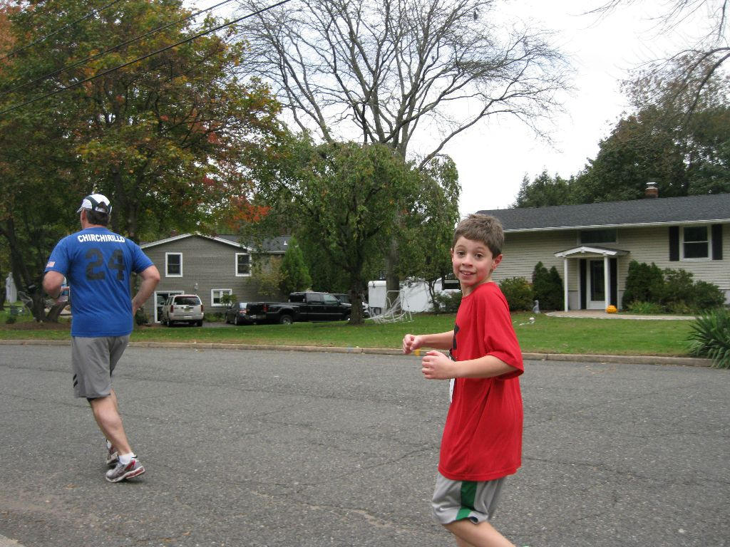 A boy in red running