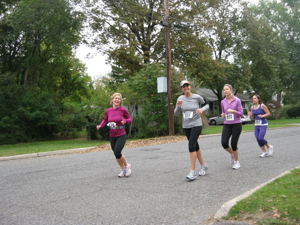 A group of ladies running outside