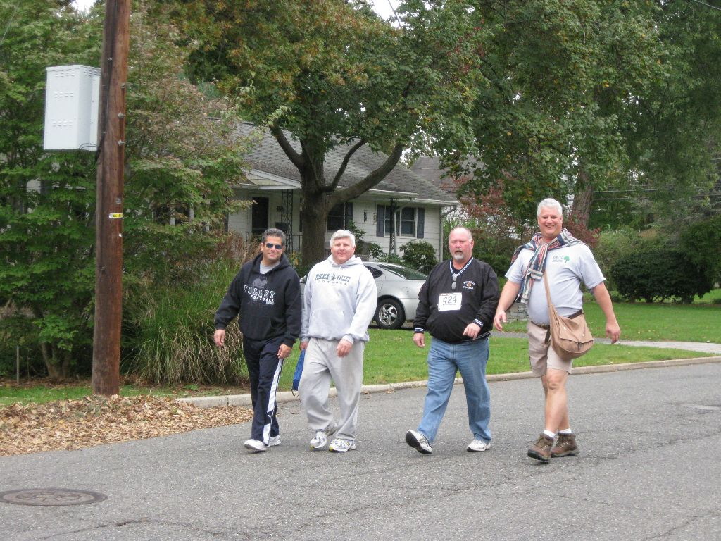 A group of men walking outside
