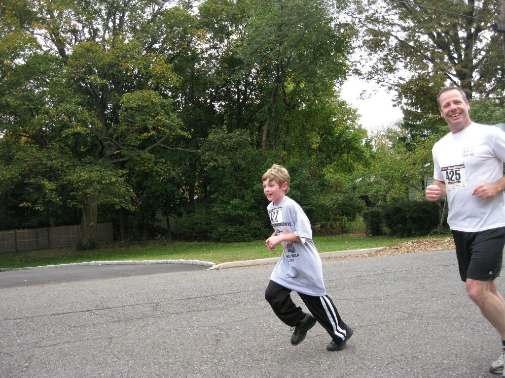 A man and a boy running outside