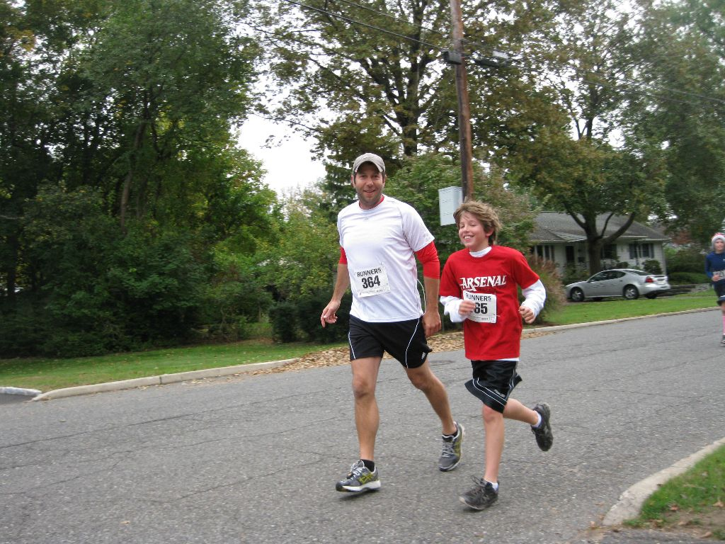 A man and boy in red running