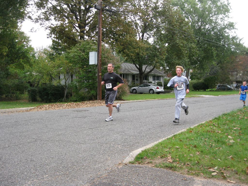 A man and boy running outside