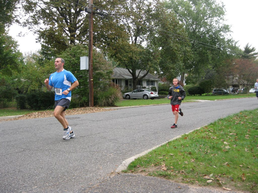 A man and young boy running