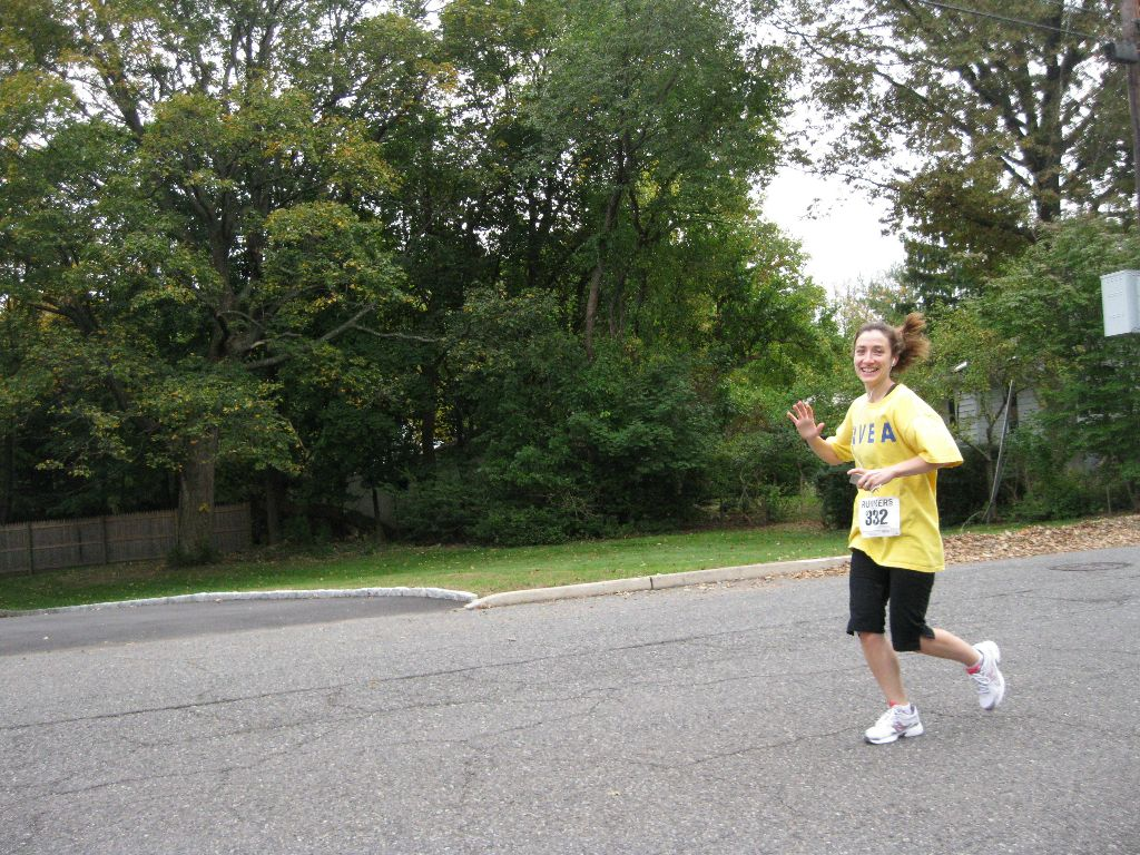 A woman running and waving