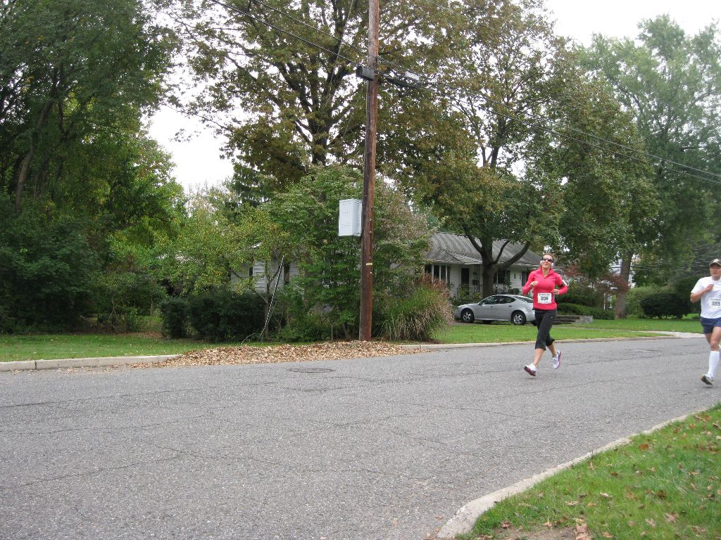Woman in pink shirt running outside