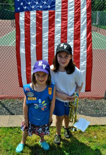 2 girls in front of an American flag