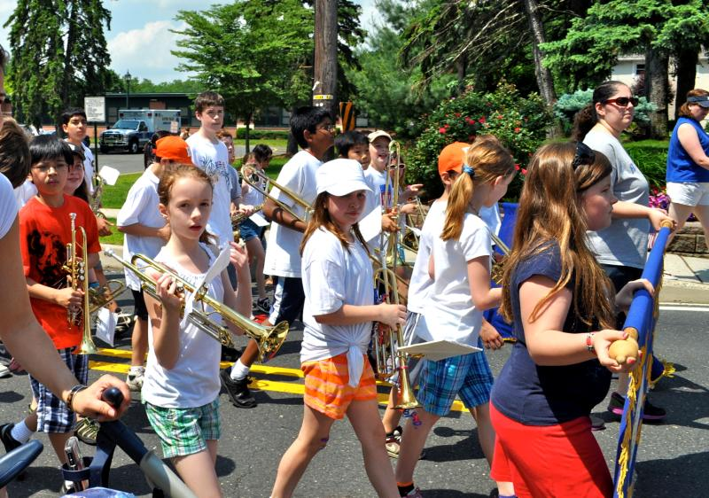 Kids holding instruments in a parade