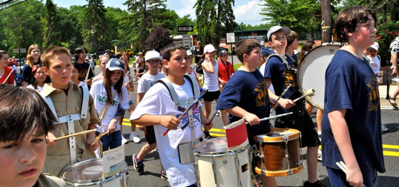 Yound kids playing drums in a parade