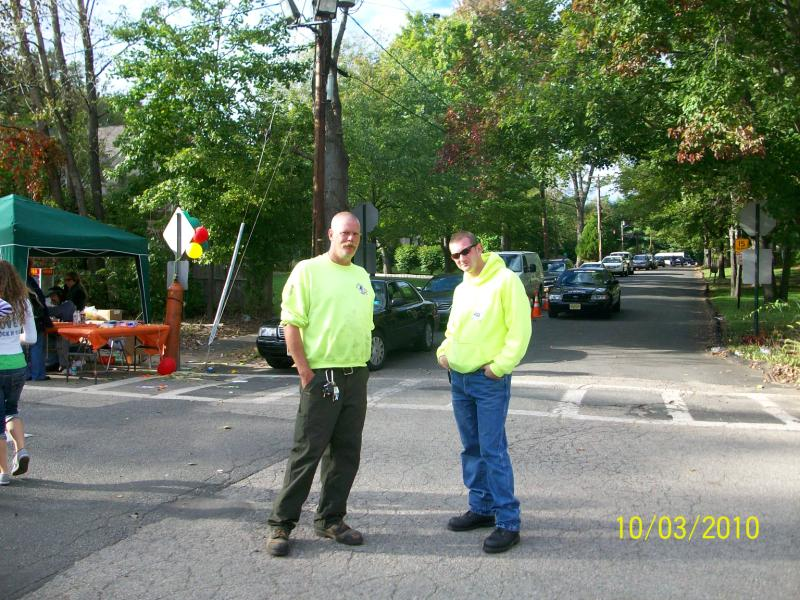 2 men in matching neon green jackets